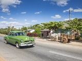 50s American Car Passing Ox and Cart, Pinar Del Rio Province, Cuba Photographic Print by Jon Arnold