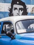 Classic American Car and Cuban Flag, Habana Vieja, Havana, Cuba Photographic Print by Jon Arnold