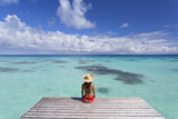 Woman Sitting on Jetty, Fakarava, Tuamotu Islands, French Polynesia (Mr) Photographic Print by Ian Trower