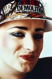 Boy George Woman's smiling wearing Sun Visor Cap Close Up Portrait Photo by  Movie Star News