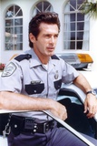 Jack Scalia in Cop Outfit Portrait Photo by  Movie Star News