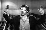 Chevy Chase in Black Suit With Pistol Photo by  Movie Star News