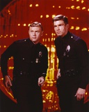 Adam-12 Posed with his Partner Inside the Building in a Movie Scene Photo by  Movie Star News