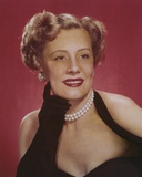 Irene Dunne wearing a Black Halter Dress with Pearl Necklace Photo by  Movie Star News
