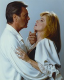 Hart To Hart Man in White Long Sleeve Suit hugging a Woman Photo by  Movie Star News
