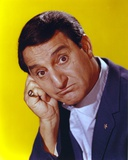 Danny Thomas Posed in Black Coat in Yellow Background Photo by  Movie Star News