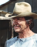 Charles Bronson smiling in Blue Shirt and Brown Hat Photo by  Movie Star News