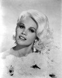 Carroll Baker wearing a Ruffled Dress with Earrings Photo by  Movie Star News