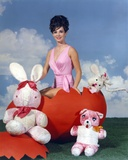 Gila Golan Posed on Red Cracked Egg in Pink Dress Photo by  Movie Star News