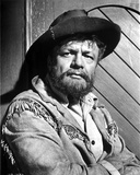 Brian Keith sitting in Cowboy Attire Photo by  Movie Star News