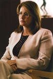 Lorraine Bracco sitting in White Blazer with Printed Blouse Under Photo by  Movie Star News