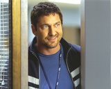 Gerard Butler smiling wearing Jacket Portrait Photo by  Movie Star News