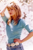 Rebecca Demornay Hand on Hips Pose wearing Blue Sweater Photo by  Movie Star News