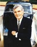 Gene Barry in Black Suit Leaning on Car Photo by  Movie Star News