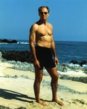 Fred Dryer standing on Sand in Swimming Trunks Photo by  Movie Star News