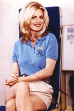Kristin Bauer Seated in Blue Golfer Shirt Photo by  Movie Star News