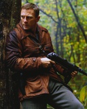 Daniel Craig Holding Firearms in Brown Leather Coat Photo by  Movie Star News