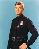 Adam-12 Posed in Police Uniform with Light Blue Background Photo by  Movie Star News
