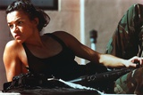Michelle Rodriguez Lying on Bed in Black Shirt With Rifle Photo by  Movie Star News