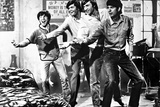 Monkees smiling in Black and White Photo by  Movie Star News