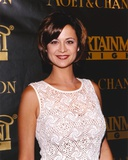 Catherine Bell posed in White Dress Portrait Photo by  Movie Star News