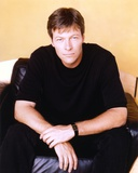 Jack Wagner sitting on a Couch in Black Shirt Photo by  Movie Star News