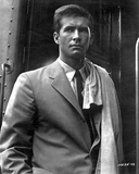 Anthony Perkins standing in White Suit Photo by  Movie Star News