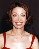 Illeana Douglas Posed in a Red Dress with a Necklace Photo by  Movie Star News