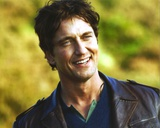 Gerard Butler smiling wearing Leather Coat Portrait Photo by  Movie Star News