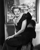 Irene Dunne on Black Elegant Dress sitting Portrait Photo by  Movie Star News