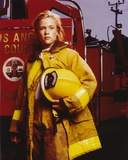 Christine Elise standing in Firefighter Outfit Photo by  Movie Star News