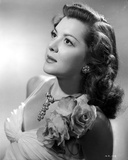 Ann Rutherford Facing Up wearing a Dress With Floral a Flower on the Shoulder Photo by  Movie Star News