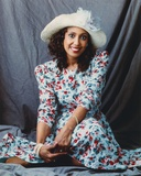 Portrait of Telma Hopkins posed in Floral Dress with Hat Photo by  Movie Star News