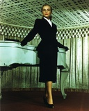 Lizabeth Scott in Black Office Attire Portrait Leaning on Piano Photo af Movie Star News