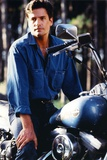 Time Trax Posed in Blue Motorcycle Photo by  Movie Star News