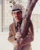 Dennis Weaver standing Under the Tree wearing Brown Suit Photo by  Movie Star News