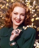 Linda Darnell in Black Coat with Flowers Portrait Photo by  Movie Star News