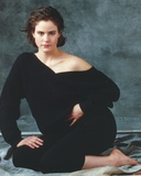 Ally Sheedy sitting on the Floor wearing Black Long Sleeves and Pants while Bare Footed Portrait Photo by  Movie Star News