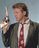 David Rasche Holding a Pistol in Black Suit with Red Tie Photo by  Movie Star News
