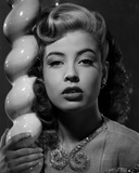 Gloria DeHaven in A Portrait Leaning On A Pole in Black and White Photo by  Movie Star News