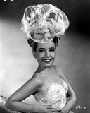 Gloria DeHaven smiling in A Portrait wearing A Feather Hat Photo by  Movie Star News