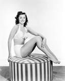 Esther Williams sitting on a Couch in White Lingerie Photo by  Movie Star News