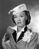 Eve Arden on Blazer and Hat sitting Portrait Photo by  Movie Star News