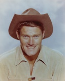 Chuck Connors smiling in Cowboy Outfit Portrait Photo by  Movie Star News