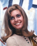 Olivia John smiling in Brown Sweater Photo by  Movie Star News