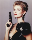 Fiona Fullerton in Black Dress with Pistol Portrait Photo by  Movie Star News