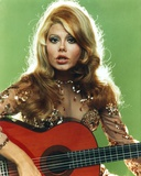 Charo Playing Guitar in Gray Background Photo by  Movie Star News