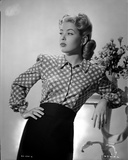 Gloria DeHaven posed in Checkered Dress in Black and White Photo by  Movie Star News