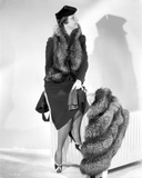 Irene Castle sitting on a Stripe Chair with Furry Coat Photo by  Movie Star News