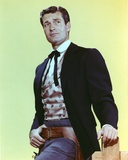 Hugh O'Brien wearing a Suit on Yellow Background Photo by  Movie Star News